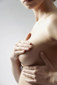 Woman touching her breast